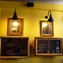 The wall cases were constructed out of vintage picture frames.