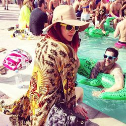 While we're definitely loving this chick's kimono, we can't help but wonder how she's not sweating her face off.