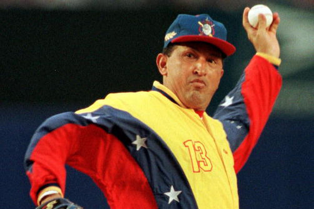 Hugo Chavez throws out the first pitch at Shea Stadium on June 9, 1999.