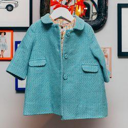 """Nightingale Coat, <a href=""""http://www.caramel-shop.co.uk/nightingalebabycoat-turquoise-12m.html""""> $210</a>."""