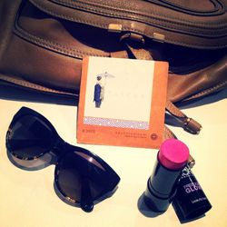 My purse essentials. I always have <b>Tatcha</b> Beauty Papers and <b>Revolution Organics</b> Beauty Balm in Blushed. The beauty balm is a multi-tasker that I can use on my cheeks and lips.