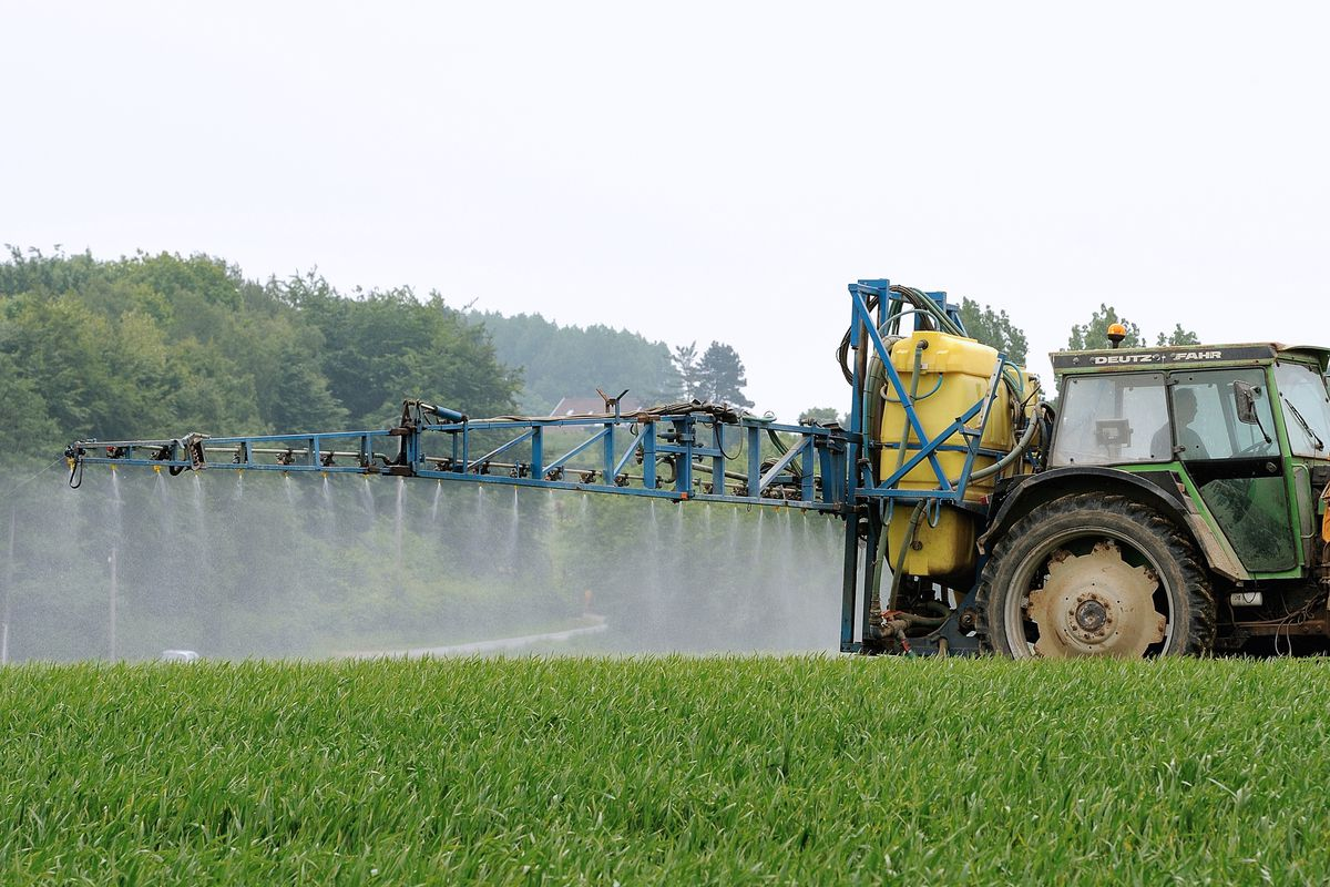 Pesticides are sprayed on to a field in France.
