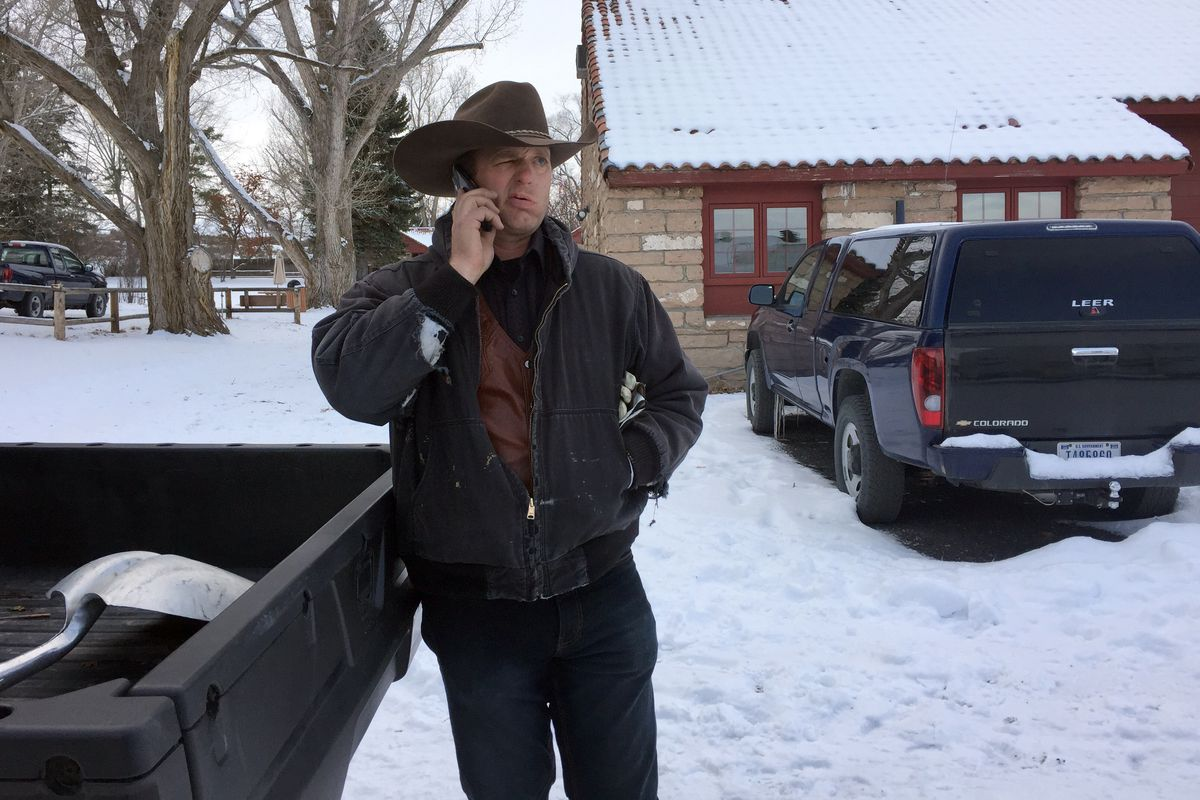 Ryan Bundy, a militia member, talks on the phone at the Malheur National Wildlife Refuge in Oregon.