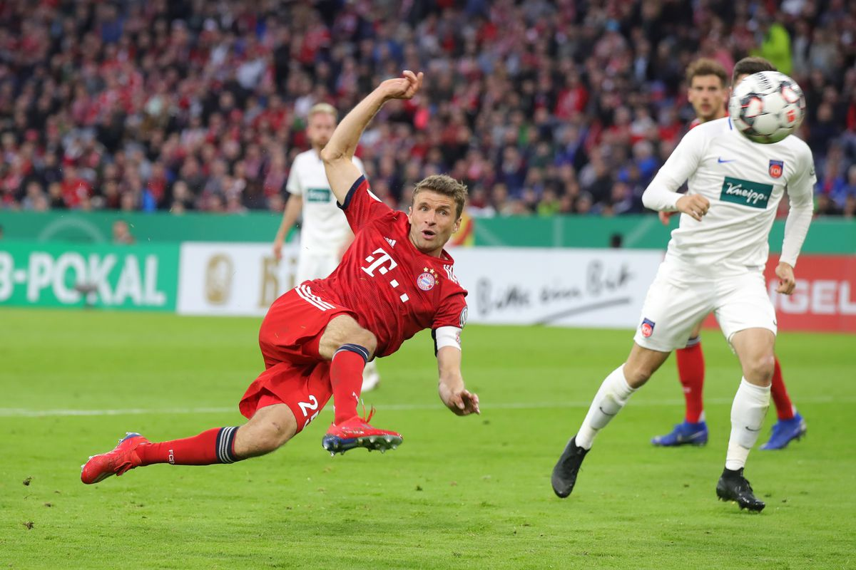MUNICH, GERMANY - APRIL 03: Thomas Mueller of Muenchen scores his team's second goal during the DFB Cup quarterfinal match between Bayern Muenchen and 1. FC Heidenheim at Allianz Arena on April 03, 2019 in Munich, Germany.
