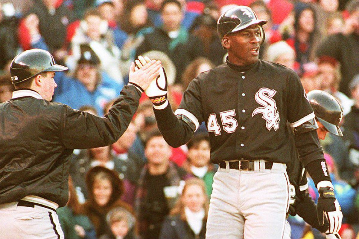 Chicago White Sox outfielder Michael Jordan (R) is