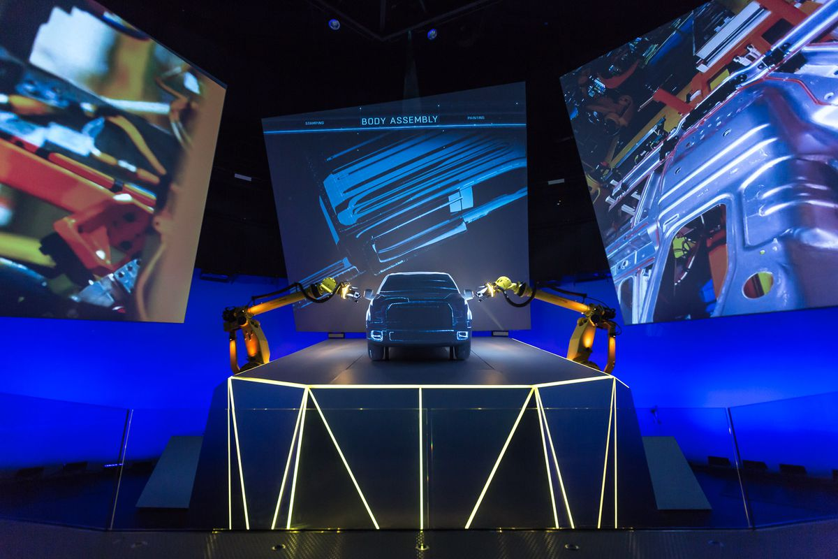 Ford's custom auditorium for showing off its new F-150 trucks includes full-size robots and enormous screens.