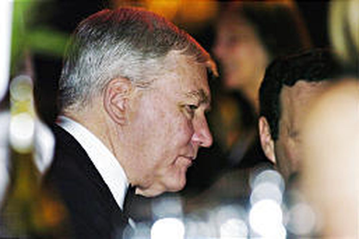 Conrad Black attends the Macleans 100th anniversary gala event in Toronto on Tuesday. Black was charged Thursday with looting millions.