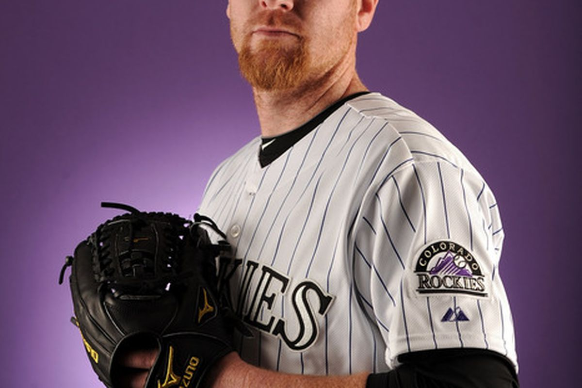 SCOTTSDALE AZ - FEBRUARY 24:  Aaron Cook #28 of the Colorado Rockies poses for a portrait during photo day at the Salt River Fields at Talking Stick on February 24 2011 in Scottsdale Arizona.  (Photo by Harry How/Getty Images)