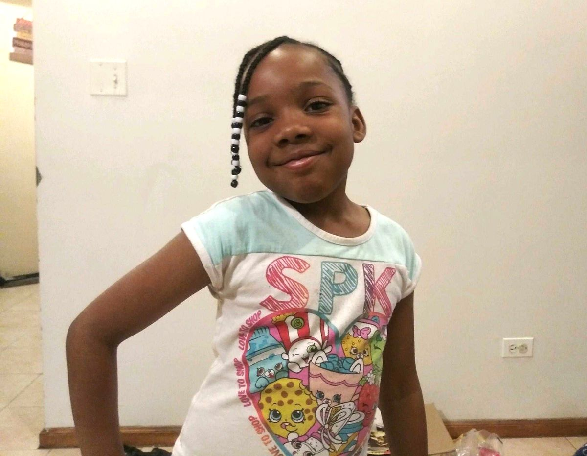 Crown Community of Fine Arts second-grader Natalia Wallace, 7, was killed July 4 while playing outside her grandmother's house at her family's Fourth of July party in Austin. Three reputed gang members have been charged with driving up to the gathering in the 100 block of North Latrobe Avenue, exiting the car and spraying bullets.