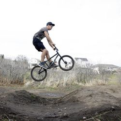 Kolby Haggard, 14, jumps his bike in West Jordan on Wednesday, Nov. 21, 2012. Utah lawmakers are pushing to add more physical activity in schools because being active increases brain function, according to a nationwide study called SPARK.