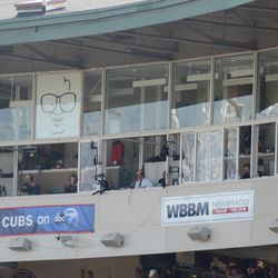 2:54 p.m. TV and radio station banners under the broadcast booths -