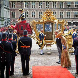 """Netherlands' King Willem-Alexander, center left, and his wife Queen Maxima, center right, arrive for the opening of the new parliamentary year with a speech outlining the government's plan and budget policies for the year ahead, at the 13th century """"Hall of Knights"""" in The Hague, Netherlands, Tuesday, Sept. 17, 2013."""