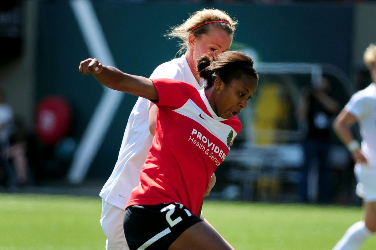Midfielder Nikki Washington (shown here with Portland) helped solidify a shaky Breakers back line by jumping into a center back position.