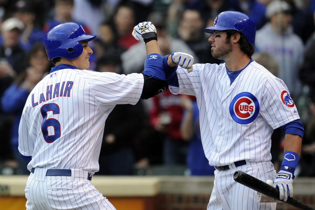 Chicago, IL, USA; Chicago Cubs first baseman Bryan LaHair celebrates his solo home run with third baseman Ian Stewart against the St. Louis Cardinals in the fourth inning at Wrigley Field.  Credit: David Banks-US PRESSWIRE