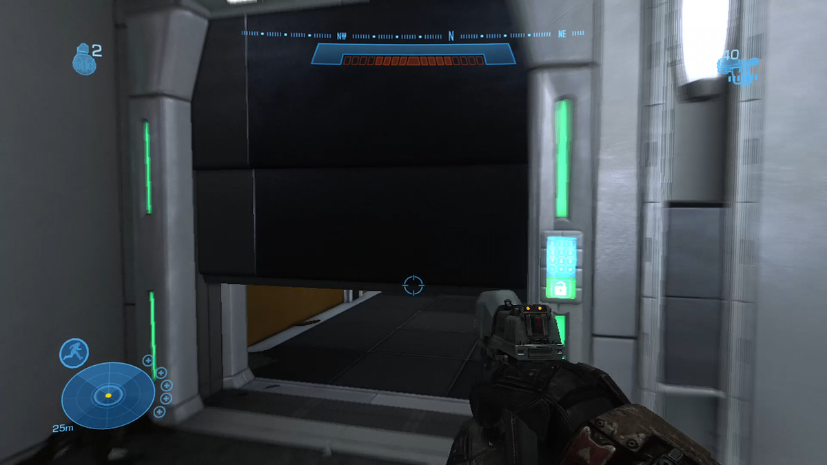 Player point of view with hand gun in the foreground shows a panel door that slides up and out of the way when a player is near it.