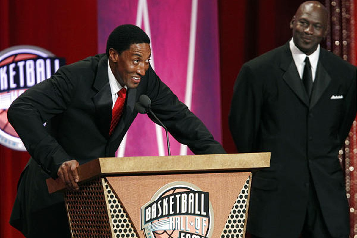 Hall of Fame inductee Scottie Pippen speaks as Michael Jordan listens during the enshrinement ceremony.