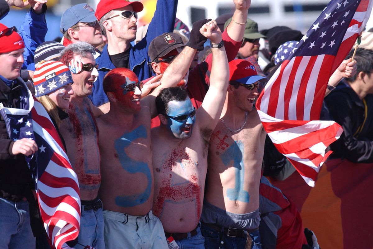 """FILE"""""""" USA fans cheer the USA Men's Moguls team in the 2002 Salt Lake City Winter Olympics.  photo by Ravell Call"""