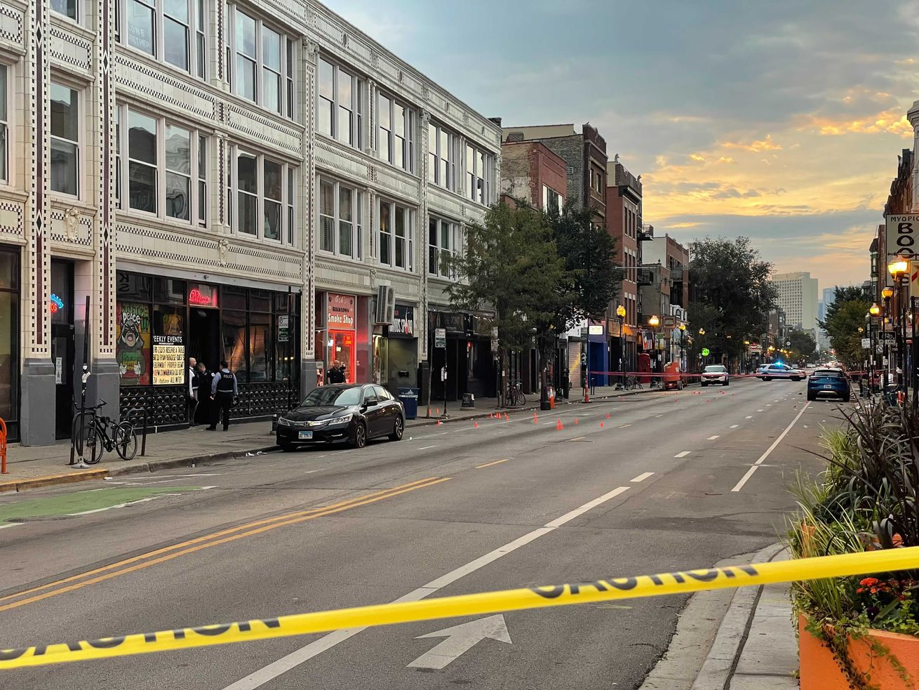 One person was killed and four others wounded in a drive-by shooting Sunday morning on Milwaukee Avenue in Wicker Park. They were among more than 40 people shot over the holiday weekend.