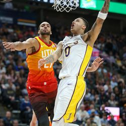 Los Angeles Lakers forward Kyle Kuzma (0) goes to the hoop past Utah Jazz center Rudy Gobert (27) during the game at Vivint Smart Home Arena in Salt Lake City on Tuesday, April 3, 2018.