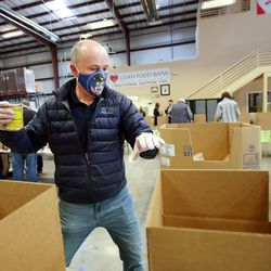 Gov.-elect Spencer Cox and members of his family sort food at the Utah Food Bank in St. George on Saturday, Jan. 2, 2021.