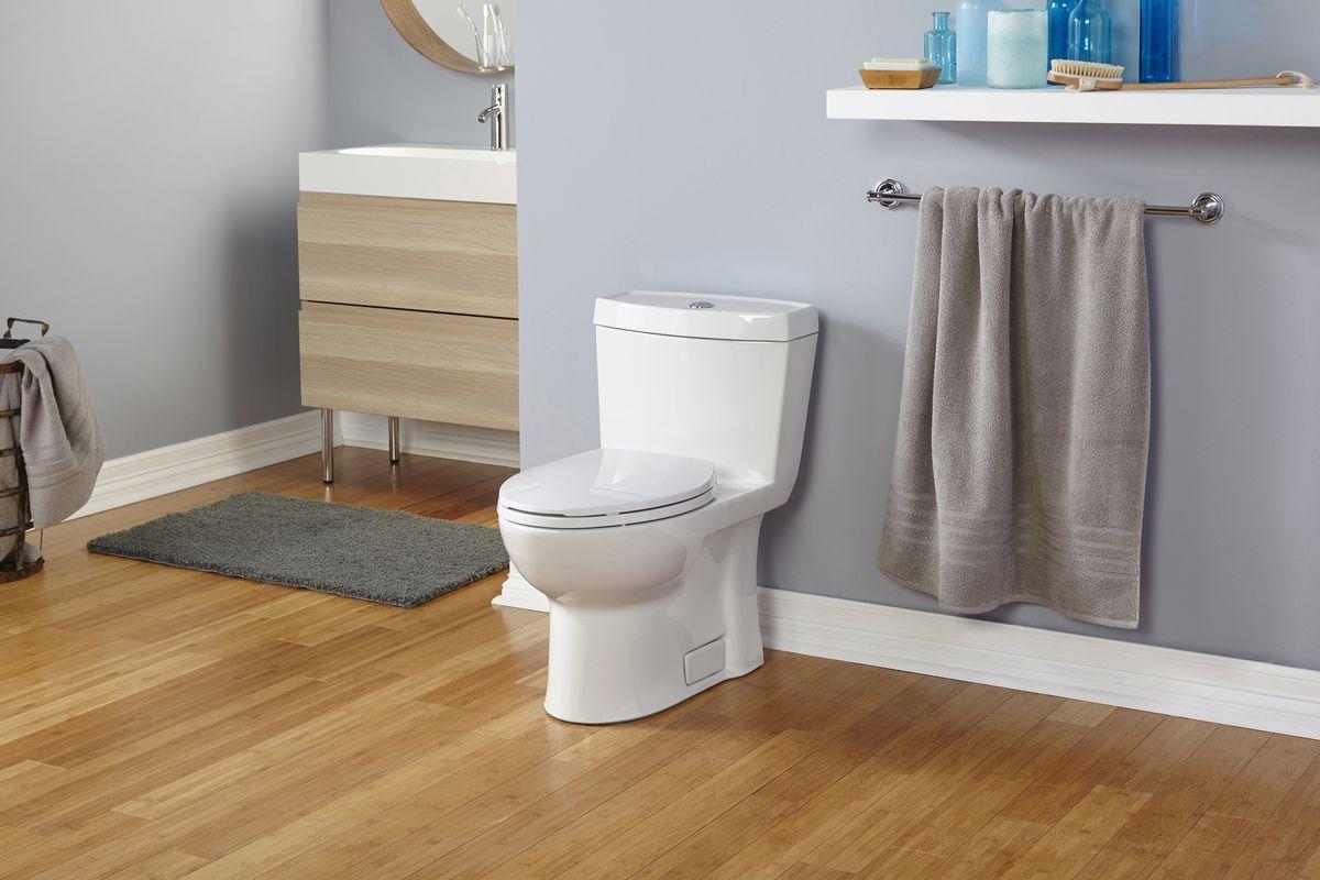 One-piece toilet in bathroom.