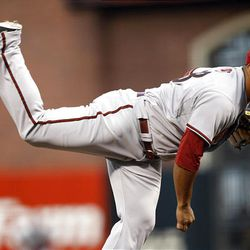 Arizona Diamondbacks starting pitcher Yusmeiro Petit throws to the San Francisco Giants during the first inning.