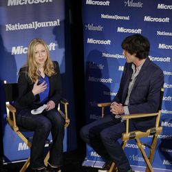 """Chelsea Clinton moderates a town-hall style meeting called """"Conversations With the Next Generation,"""" as MTV's Andrew Jenks listens, Wednesday, Sept. 5, 2012, in Charlotte, N.C., during the second day of the Democratic National Convention."""