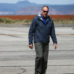 FILE - Interior Secretary Ryan Zinke arrives in Blanding Utah before taking a flight around the Bears Ears National Monument with State leadership on Monday, May 8, 2017. Zinke released an executive summary of his findings from a 120-day review of 27 national monuments. The report says some monument designations clearly stretched definitions in the 1906 Antiquities Law, but it lacks specifics.