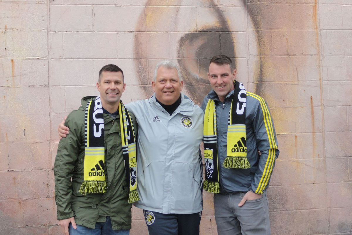 The author Joseph Mitchell, center, with his married friends Greg Zunkiewicz, left, and Rob Broadbent at a Columbus Crew game