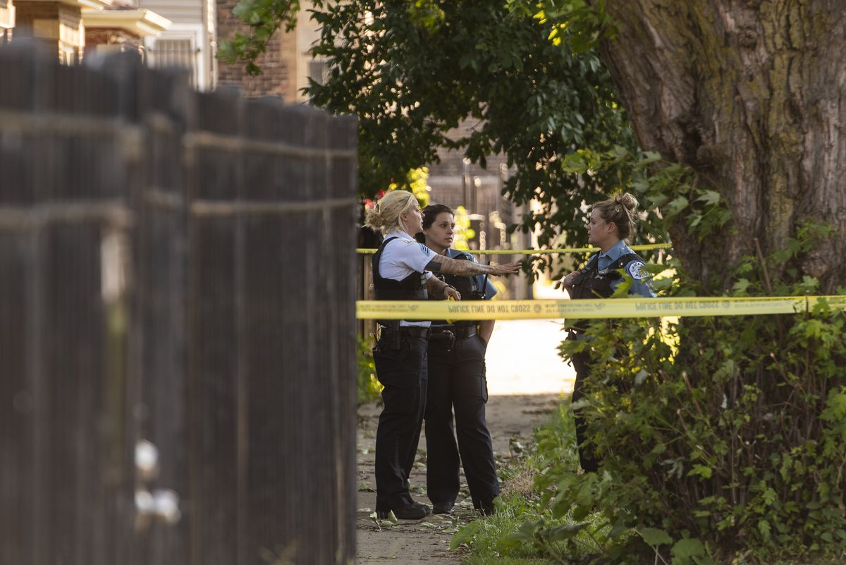 Chicago police investigate the scene Thursday where two people were shot, including a 5-year-old child, in the 700 block of West 50th Place.
