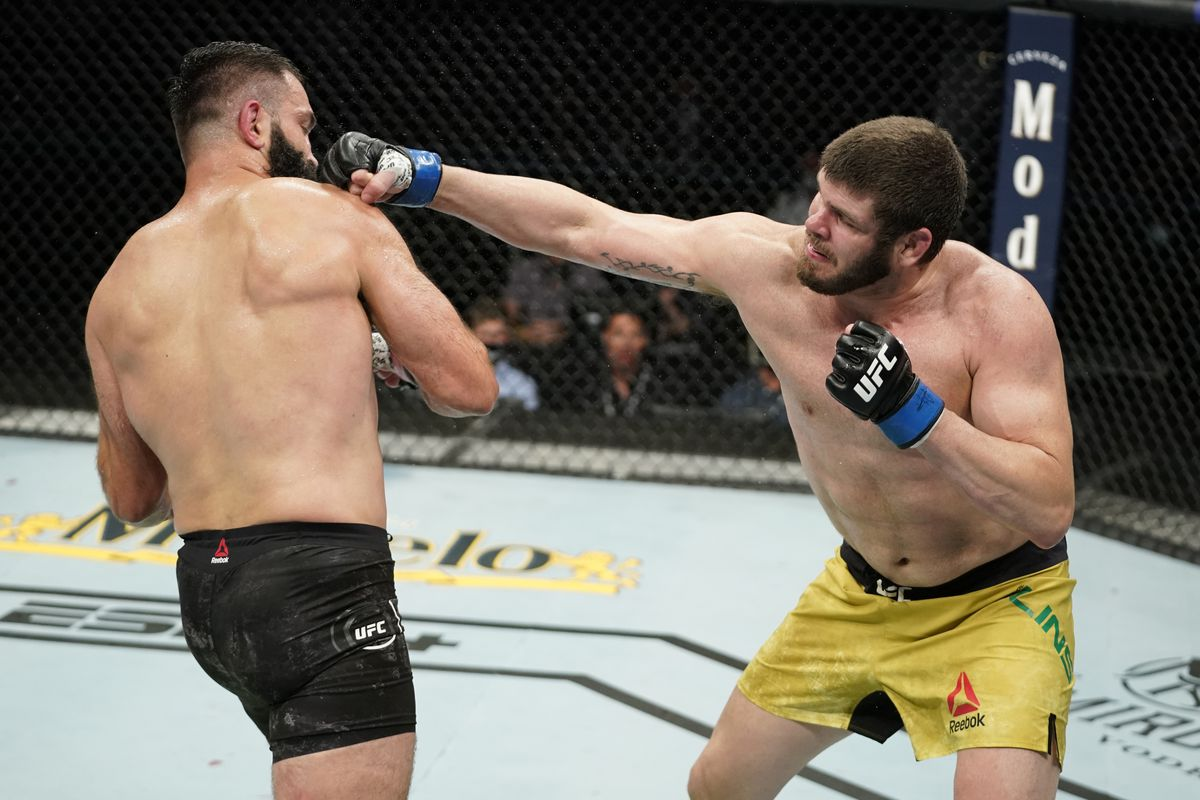 Philipe Lins of Brazil punches Andrei Arlovski of Belarus in their heavyweight bout during the UFC Fight Night Event at VyStar Veterans Memorial Arena on May 13, 2020 in Jacksonville, Florida.