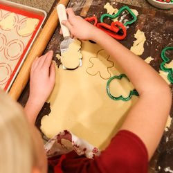 Camree Kirby, 9, cuts cookie dough during a family night at the family's home in Lehi on Thursday, Dec. 17, 2020.