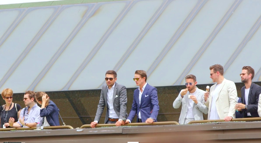 Men sizing up the crowd at Pitti Uomo in Florence