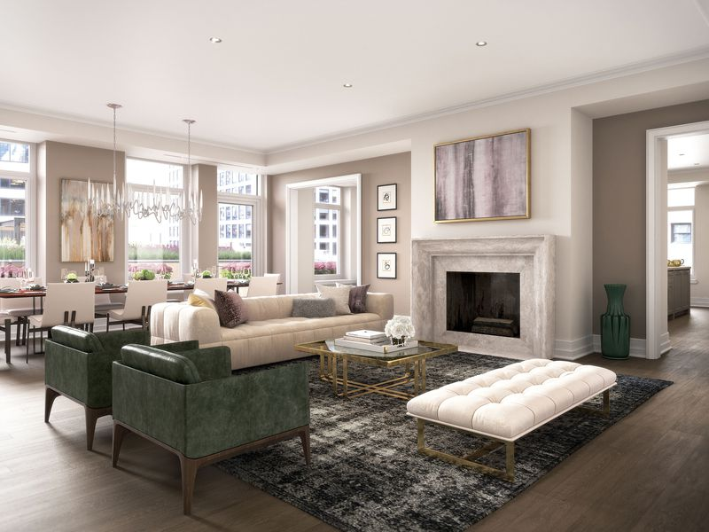 A rendering shows a luxury living room with two leather club chairs facing a marble fireplace, an adjacent upholstered white couch, and a dining room table with an expensive looking glass chandelier near three windows.