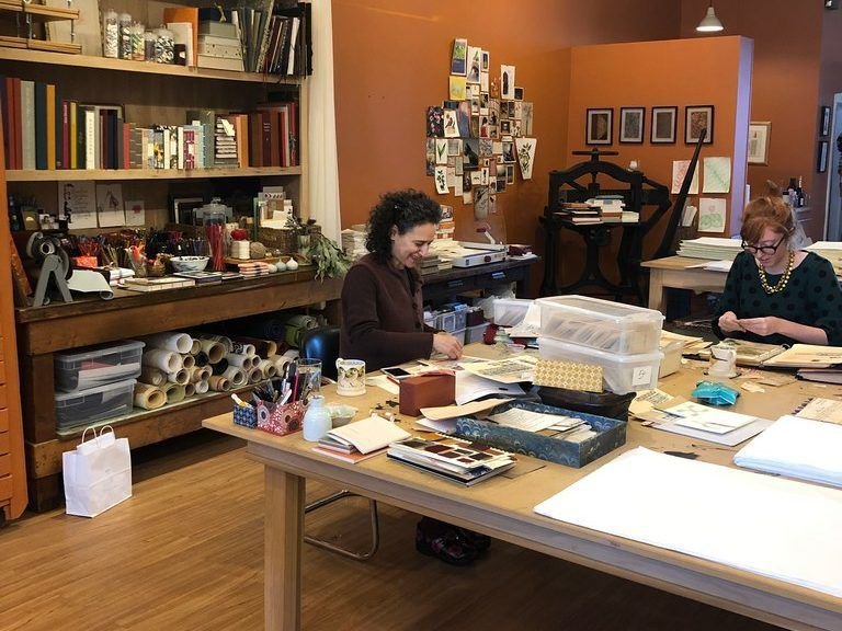 Bari Zaki (left), owner of Bari Zaki Studio, works on a project. Zaki has over 30 years of experience in European and Japanese bookbinding techniques. She also creates custom boxes and portfolios. | Ji Suk Yi for the Sun-Times