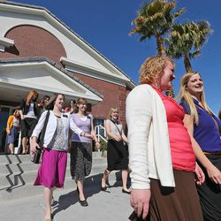 Sister missionaries leave a training meeting for the Nevada Las Vegas Mission to return to their various areas, Friday, March 14, 2014, in Las Vegas.