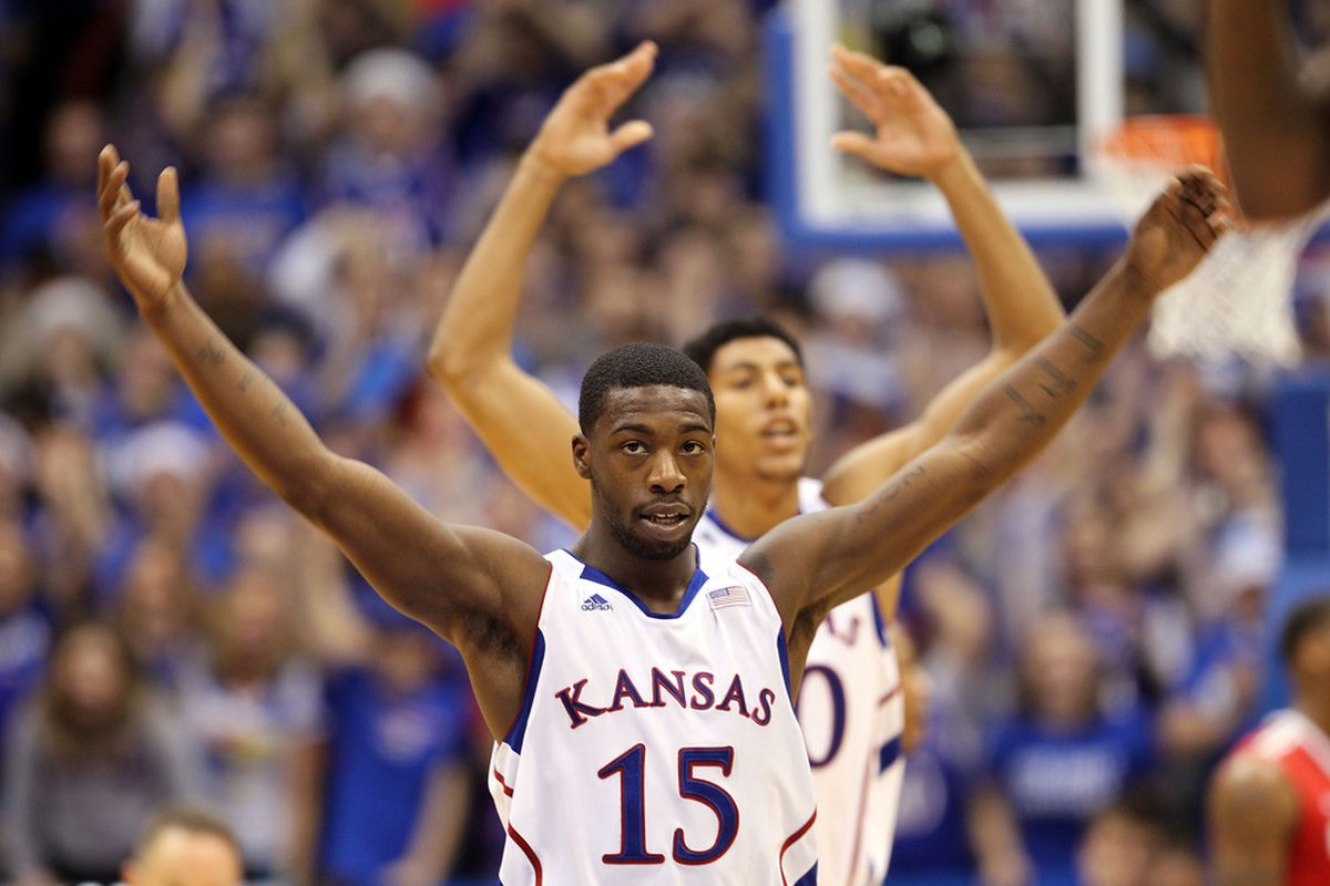 LAWRENCE, KS - DECEMBER 10:   Elijah Johnson #15 of the Kansas Jayhawks celebrates after scoring during the game against the Ohio State Buckeyes on December 10, 2011 at Allen Fieldhouse in Lawrence, Kansas.  (Photo by Jamie Squire/Getty Images)