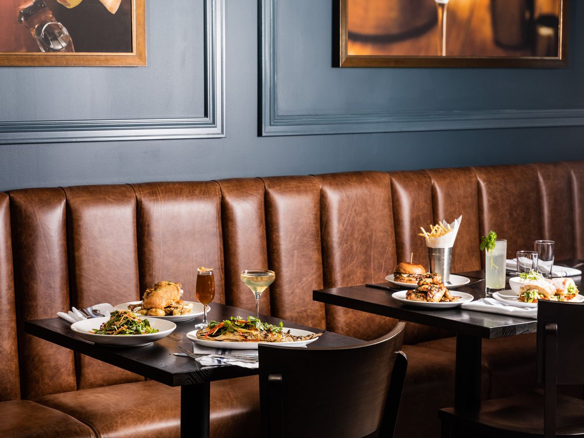 A leather banquette and a table full of food