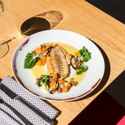 roasted sea bass with coconut curry, bok choy, baby carrots, and mussels
