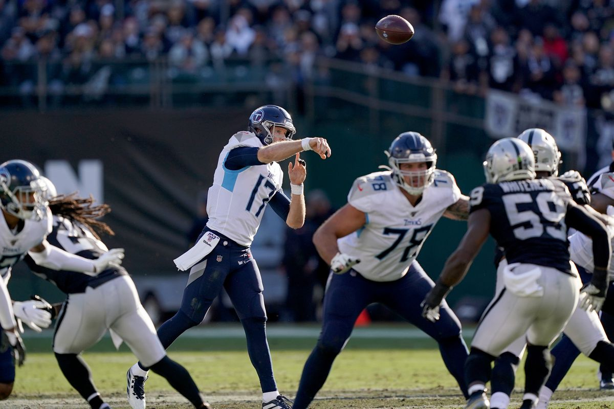 Ryan Tannehill of the Tennessee Titans throws pass against the Oakland Raiders during the first half of an NFL football game at RingCentral Coliseum on December 08, 2019 in Oakland, California.