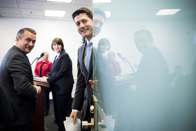 Speaker of the House Paul Ryan (R-Wisc.), alongside Rep. Don Bacon (left), closes the door as he prepares to hold a press conference following the House Republican Conference meeting in the Capitol on March 20, 2018.