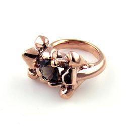 "Concrete Polish <a href=""http://shopconcretepolish.bigcartel.com/product/rose-gold-quartz-blaster-with-8mm-genuine-gemstone"">Quartz Growth Ring</a> in rose gold/quartz, $170. Upgrade to white or yellow gold; sapphires, tourmaline, or diamond stone for $16"