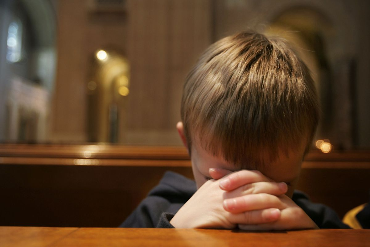A boy prays at the Basilica of the National Shrine of the Immaculate Conception in Washington, DC.