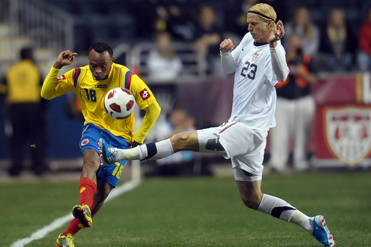 CHESTER, PA - OCTOBER 12: Brek Shea #23 of the United States tries to block a kick by Juan Camilo Zuniga #18 of Colombia at PPL Park on October 12, 2010 in Chester, Pennsylvania. The game ended in a 0-0 tie. (Photo by Drew Hallowell/Getty Images)