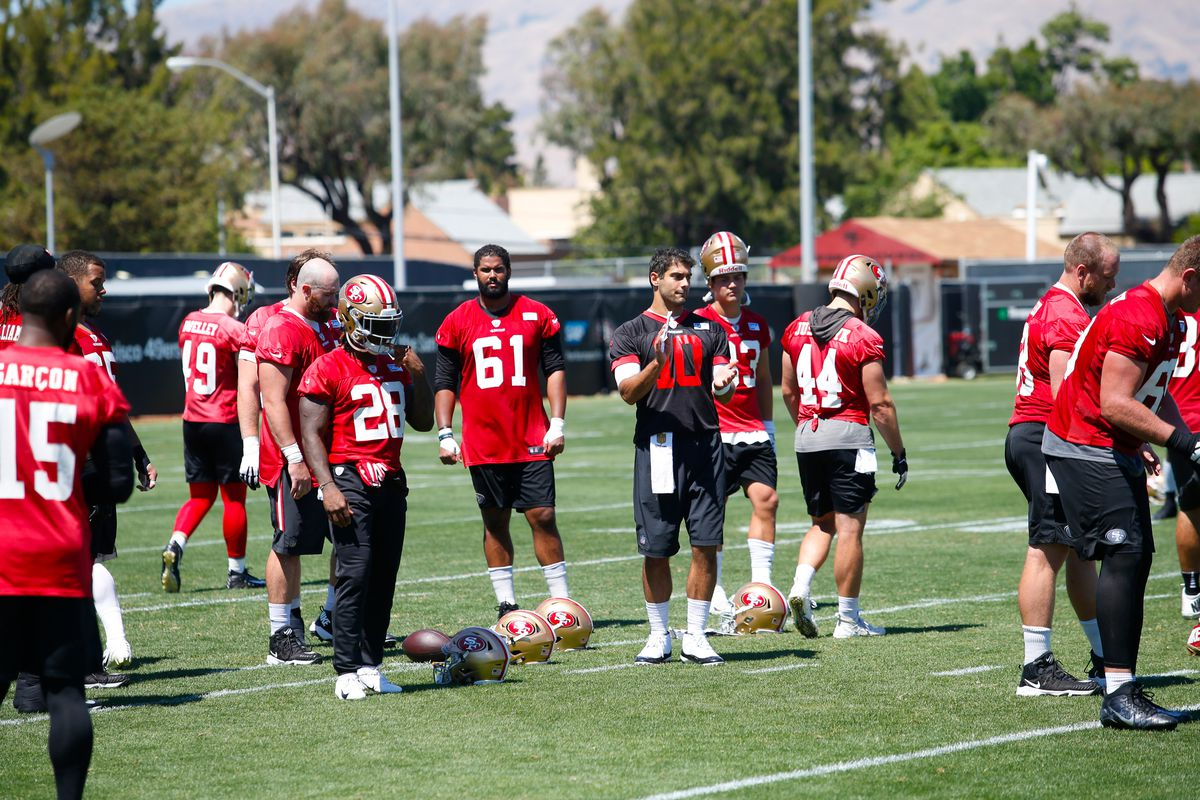 Jimmy Garoppolo of the San Francisco 49ers leads the offense through snap drills during the team Mini Camp at the SAP Training Facility on June 12, 2018 in Santa Clara, California.