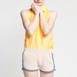 """Channel your inner sports star with these totally leg-baring (but possibly cheek-baring) luxe retro shorts from an LA-based label. Word to the wise: wear these if you're not shy. <b>Love, Zooey</b> oatmeal running shorts, $45, <a href=""""http://www.shopkosh"""