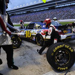 Greg Biffle (16) pits for a tire change during the NASCAR Sprint Cup Series auto race at Texas Motor Speedway, Saturday, April 14, 2012, in Fort Worth, Texas.
