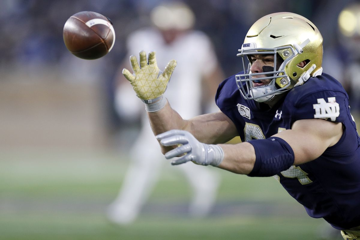 Cole Kmet #84 of the Notre Dame Fighting Irish reaches to try to catch a pass against the Boston College Eagles during a game at Notre Dame Stadium on November 23, 2019 in South Bend, Indiana. Notre Dame defeated Boston College 40-7.