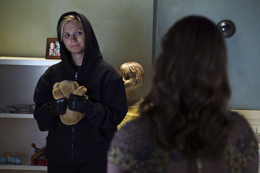 Charlotte DiLaurentis in hoodie looking sad with teddy bear in room with Alison