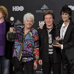 Small Faces/Faces members Ian McLagan, second from left, Kenney Jones, and Ronnie Wood, right, appear in the press room with Simply Red lead singer Mick Hucknall left, after induction into the Rock and Roll Hall of Fame Rock and Roll Hall of Fame Friday, April 13, 2012, in Cleveland. Hucknall subbed for Faces member Rod Stewart who was ill.